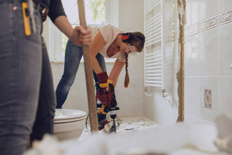 Women refurbishing bathroom