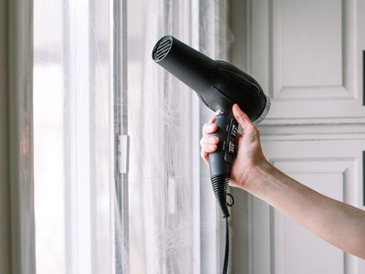 person insulating windows