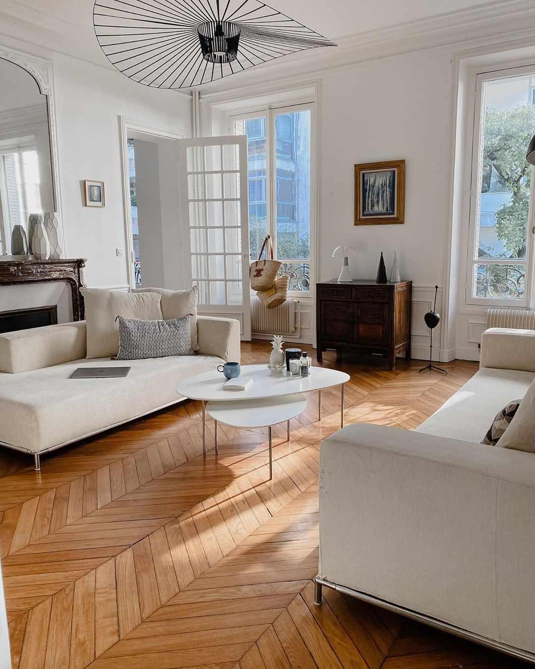 Living room with herringbone wood flooring