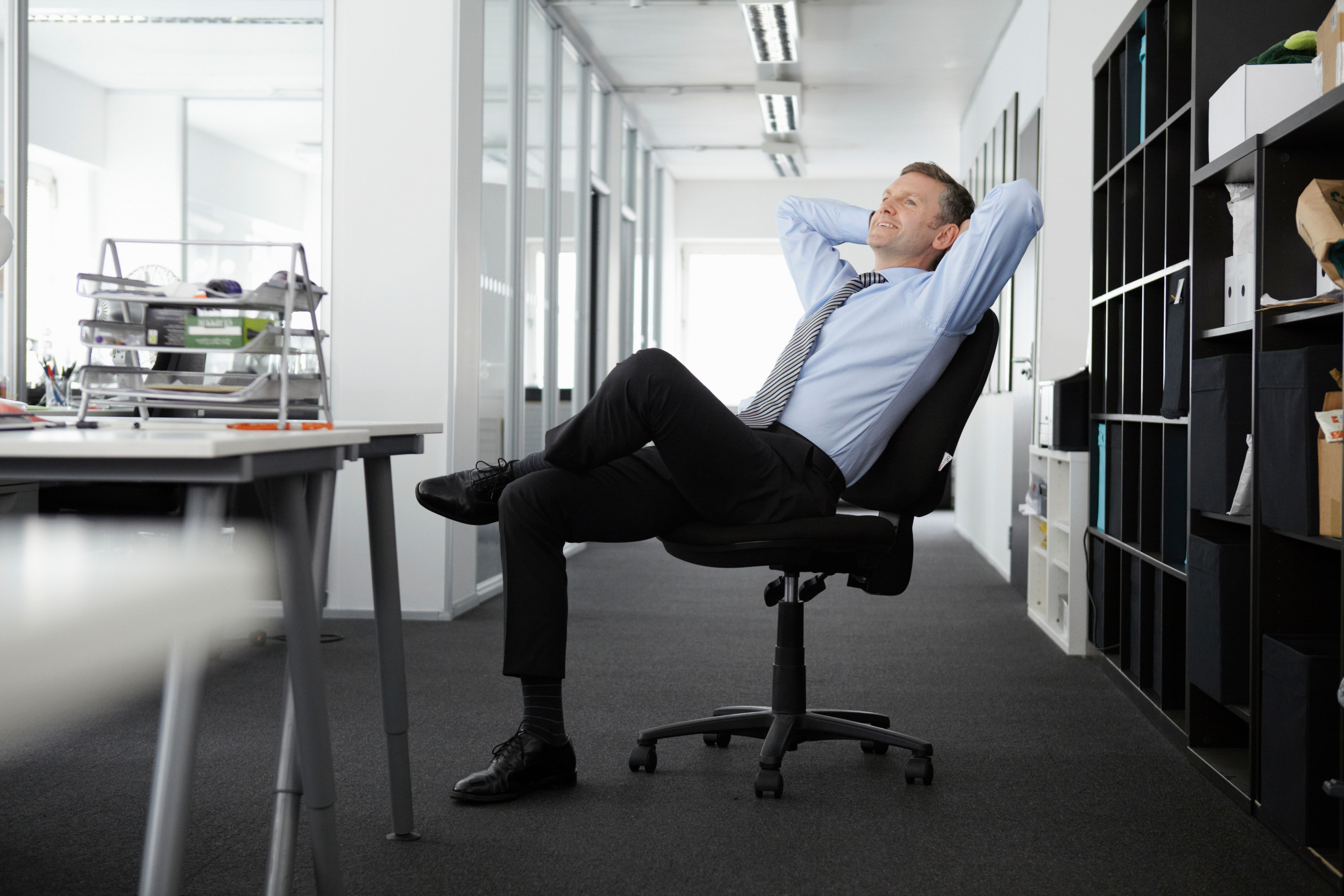 Mature businessman leaning back in an office chair