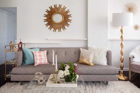 Living Room With Gray Sofa And Gold Accents