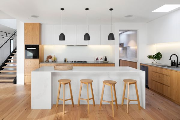 modern wood and white kitchen with a large island