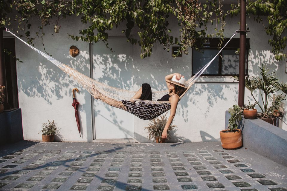 woman lounging in hammock