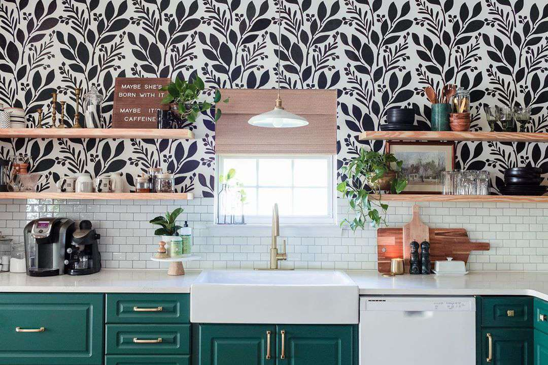 Green kitchen with black and white wallpaper