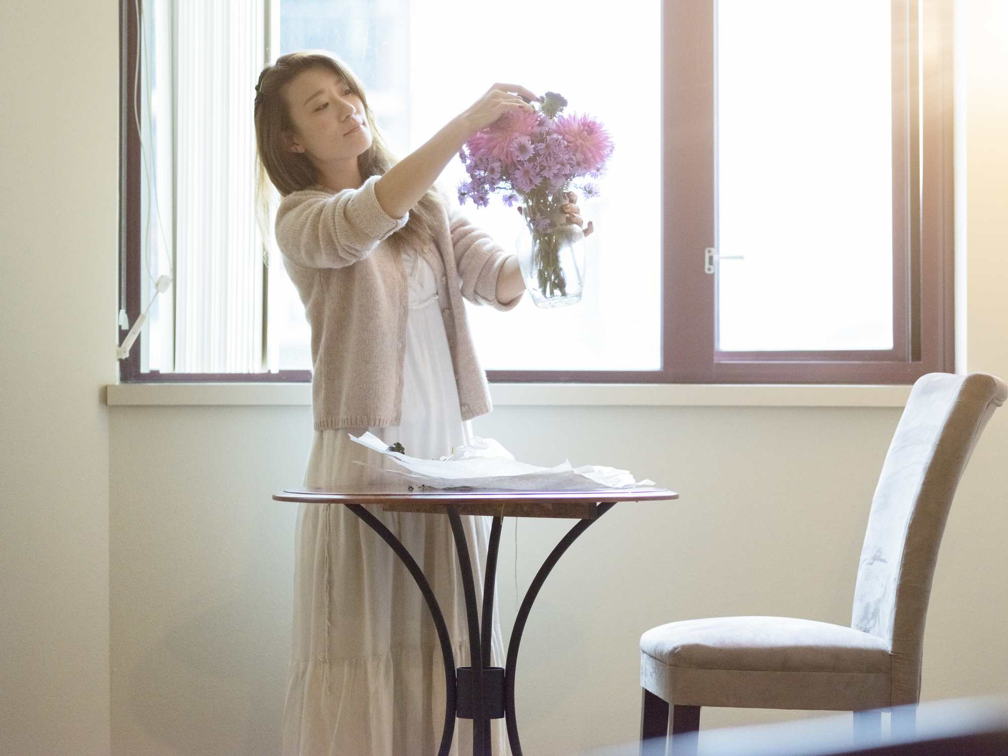 Woman arranging cut flowers
