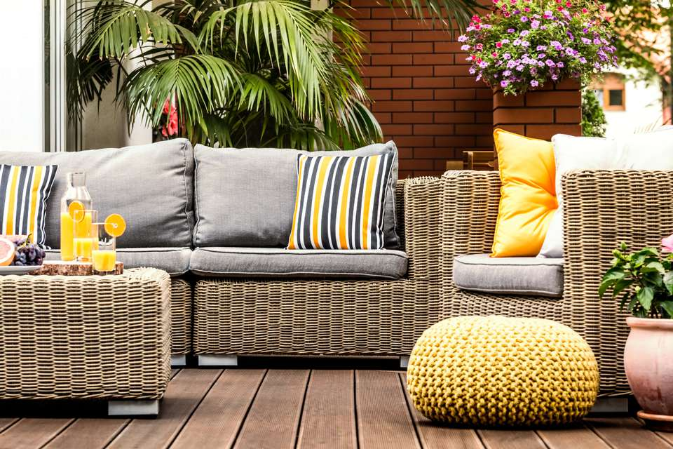 patio furniture with colorful pillows