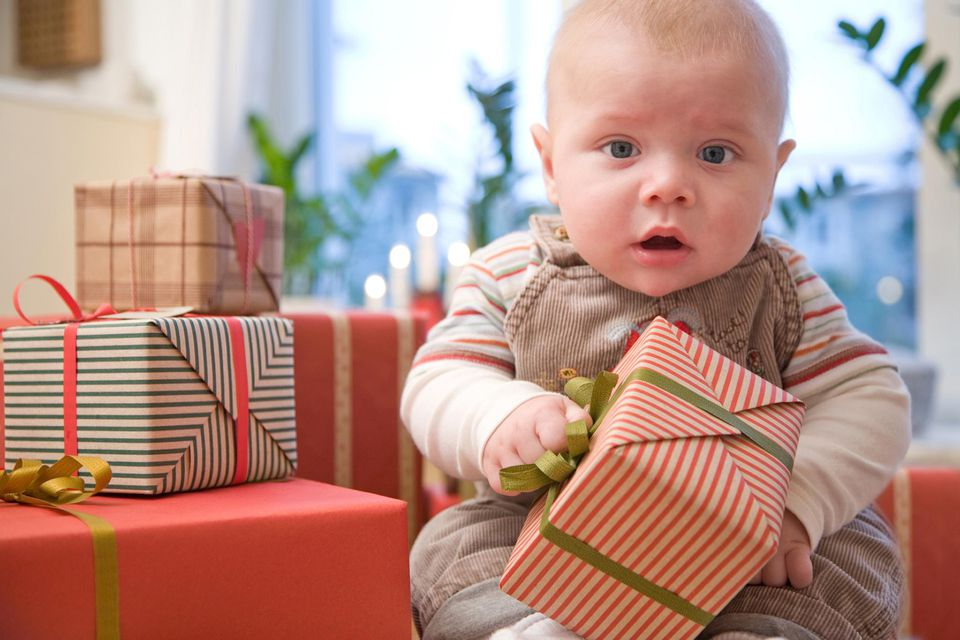 A picture of baby with a gift
