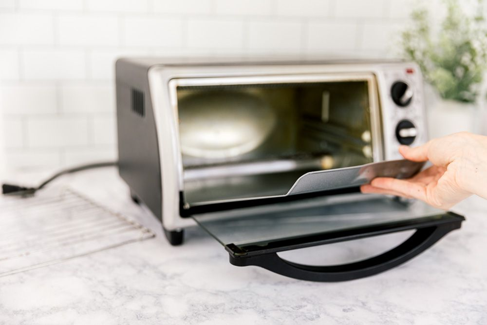 putting the toaster oven back together
