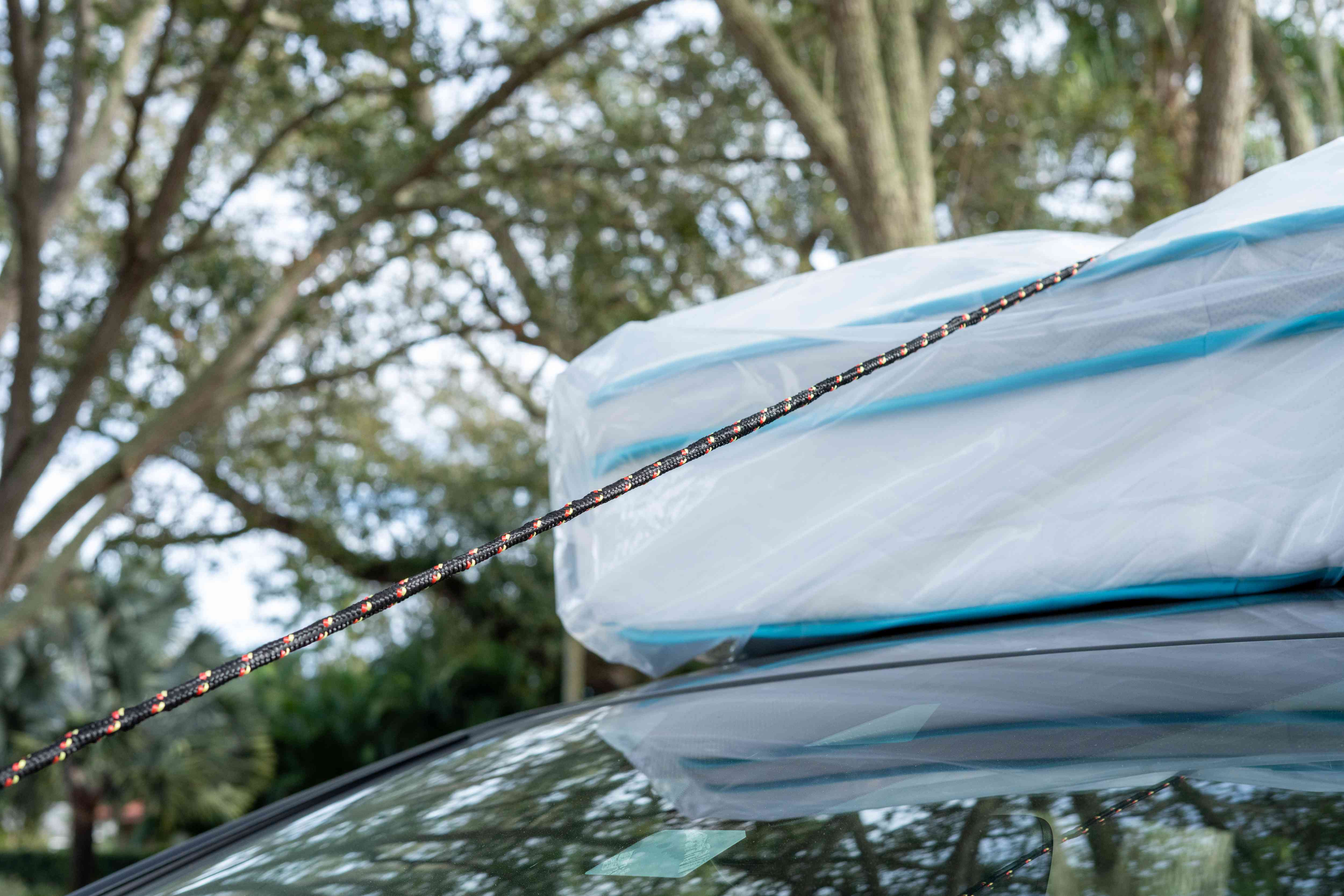 securing the mattress to the top of the car