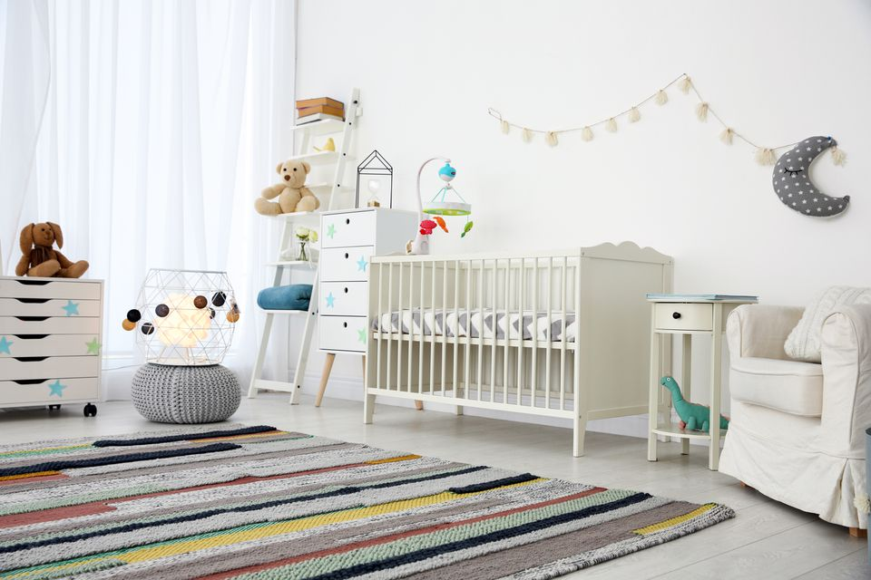 Cozy baby room interior with crib