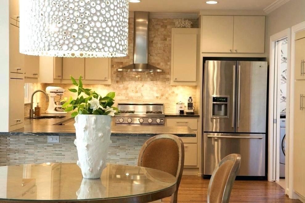 transitional kitchen with stacked stone backsplash