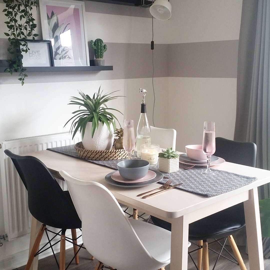 Dining room with gray striped walls