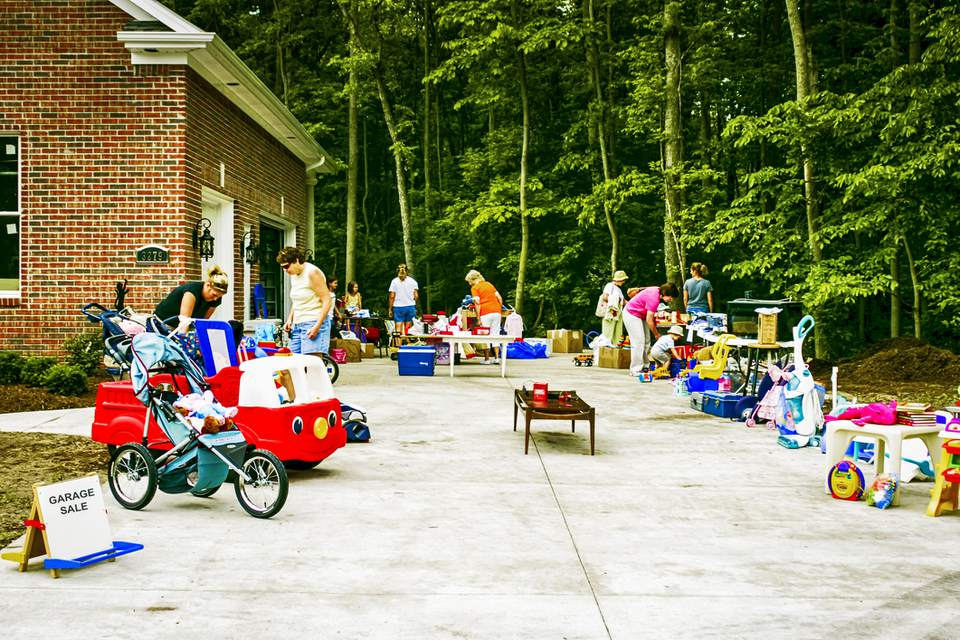 People shopping at a home garage sale
