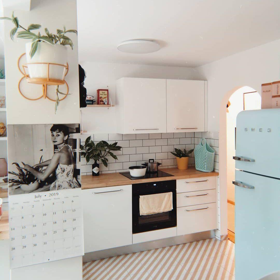 White kitchen with a retro blue fridge