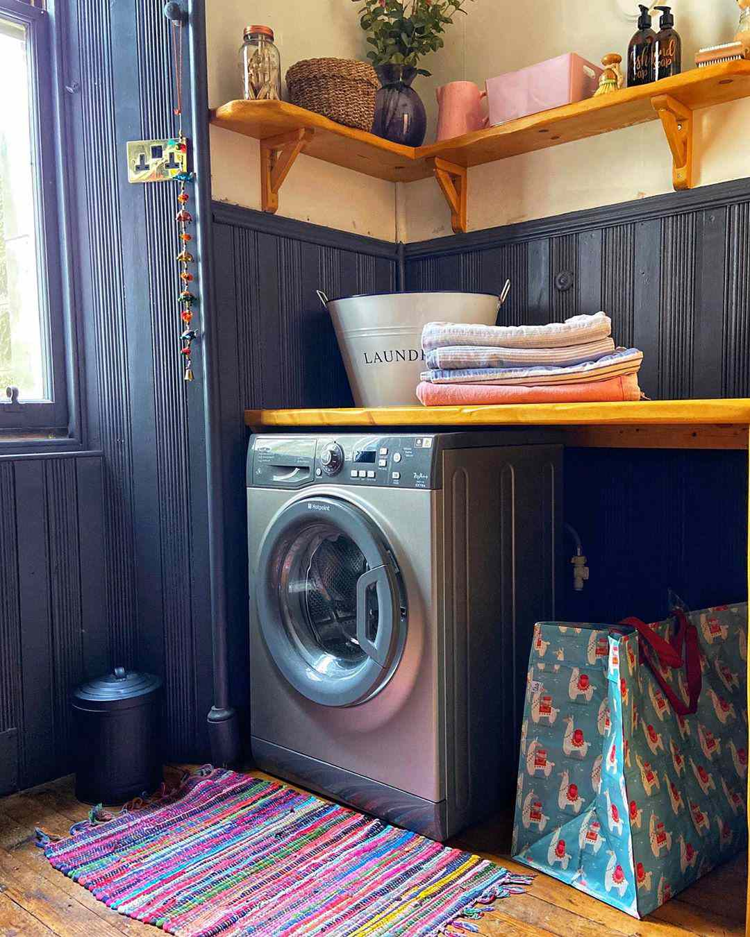 Laundry room with black paneling