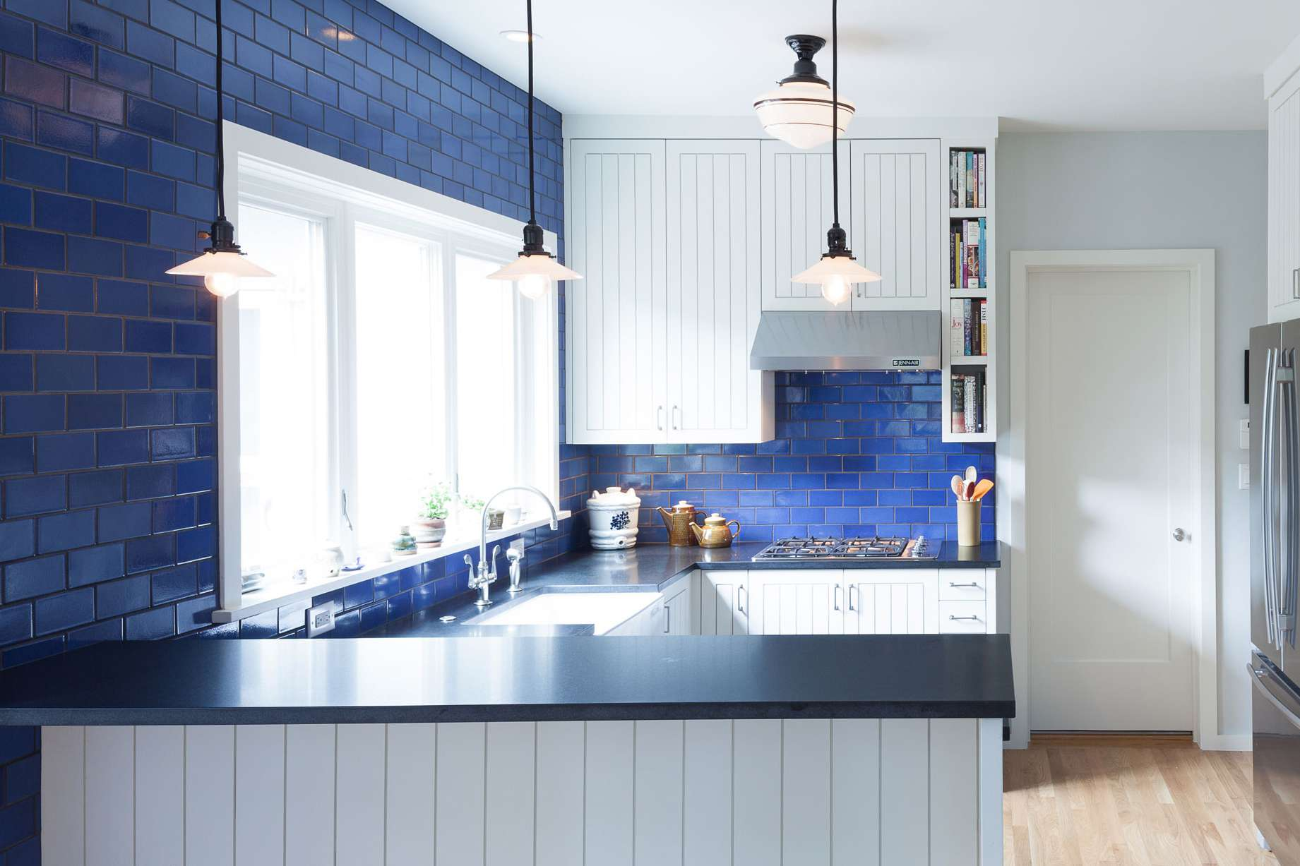 Kitchen with blue subway tiles
