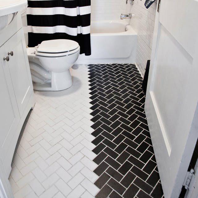 Bathroom with split black and white tile floor