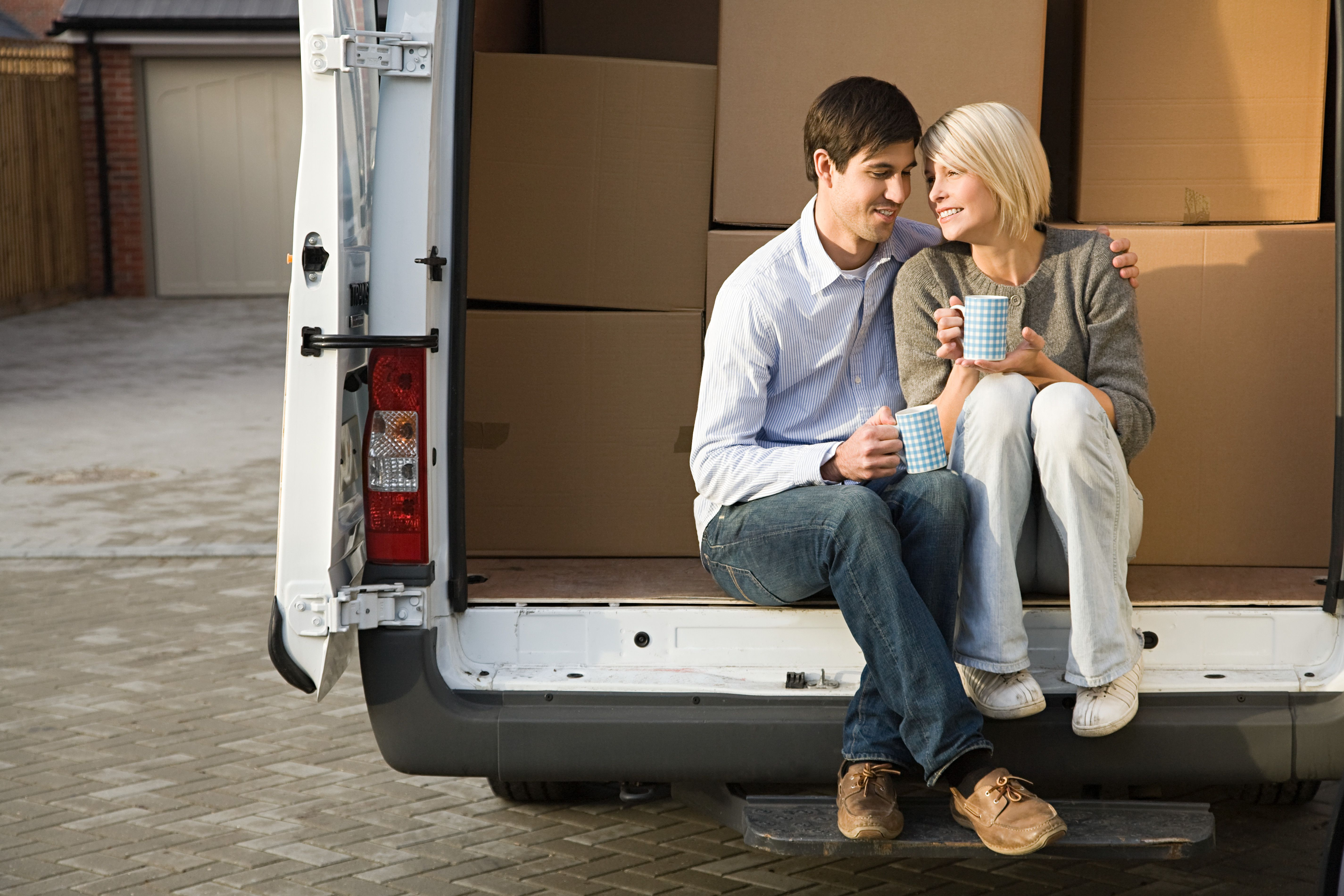 Couple in removal van