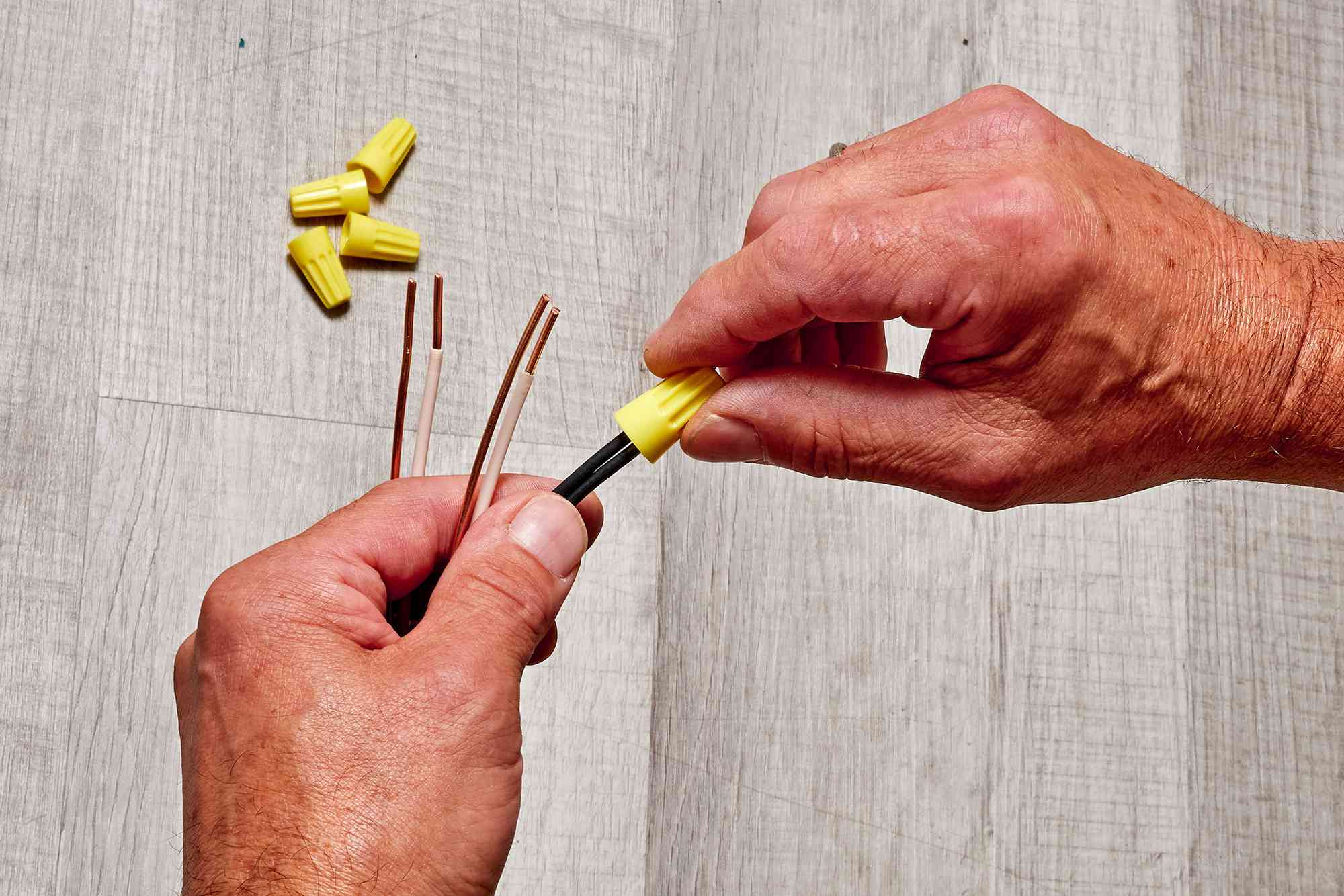 Wire ends pushed into yellow nuts and twisted around