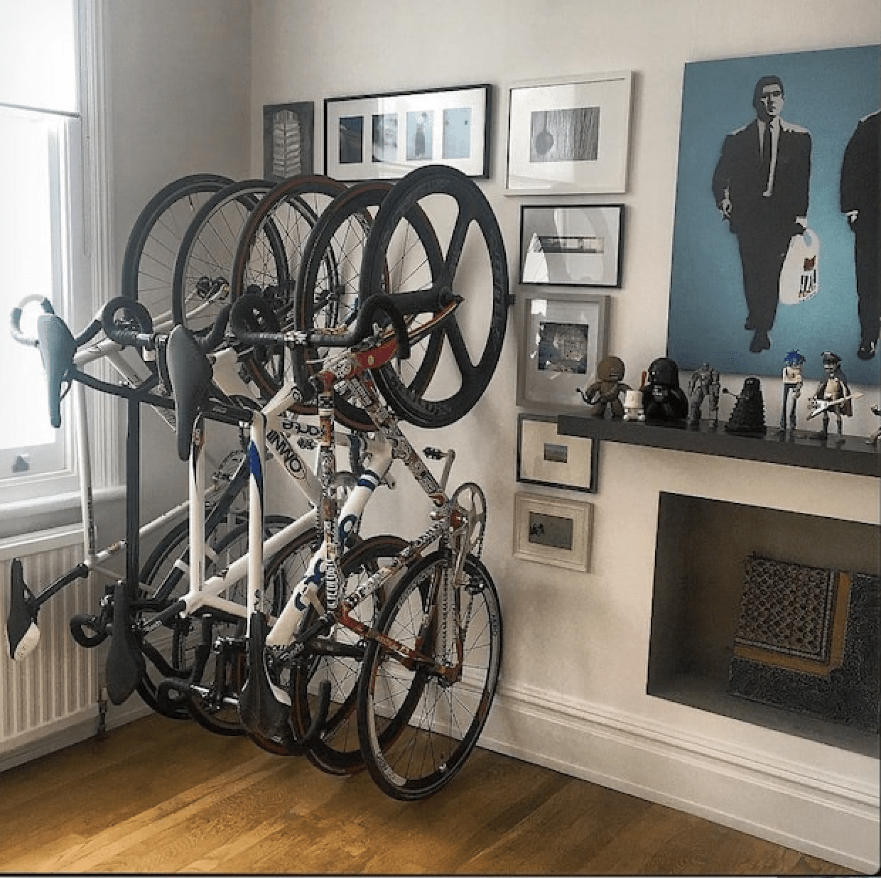 4 bikes hanging vertically inside a house