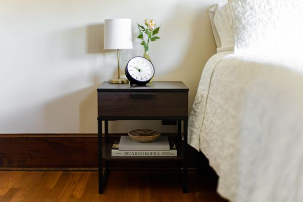 bedside table with minimal decor
