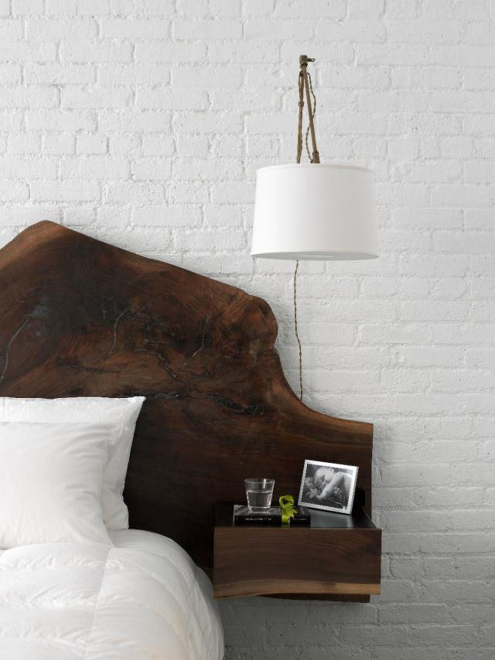 white bedroom with a hanging lamp
