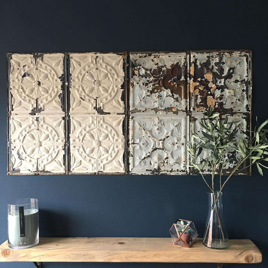 Vintage tins in various colors mounted on the wall.