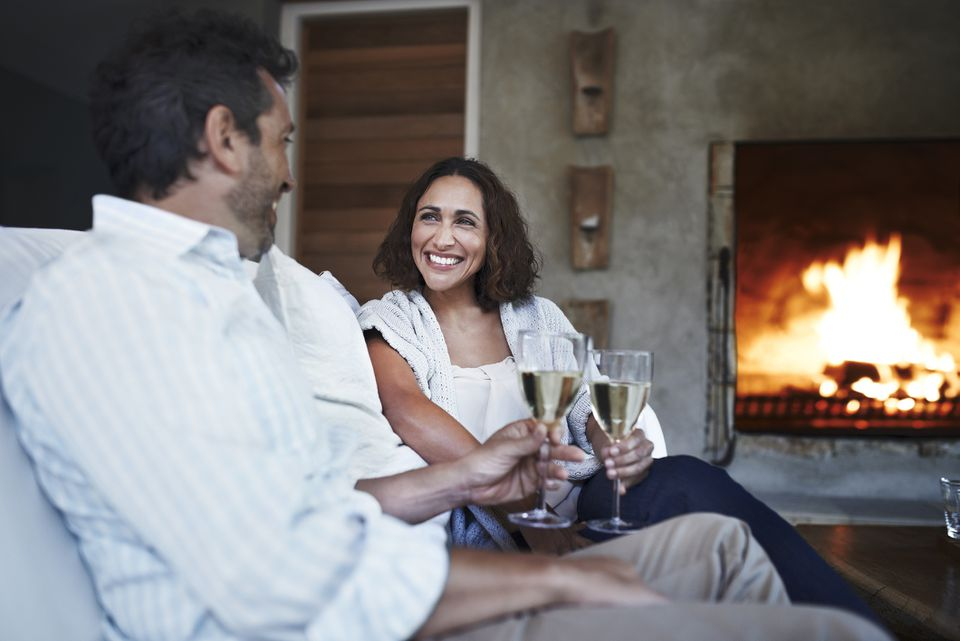 Champagne toast near fireplace