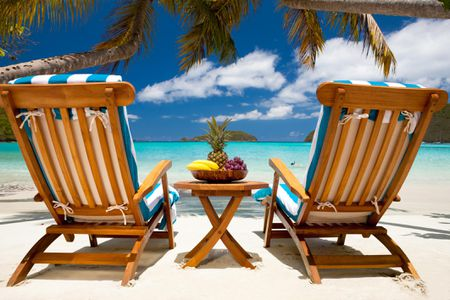 Chairs and table with fruit at a tropical Caribbean beach - Ste-by-Step Guide To Cleaning Teak Wood Furniture