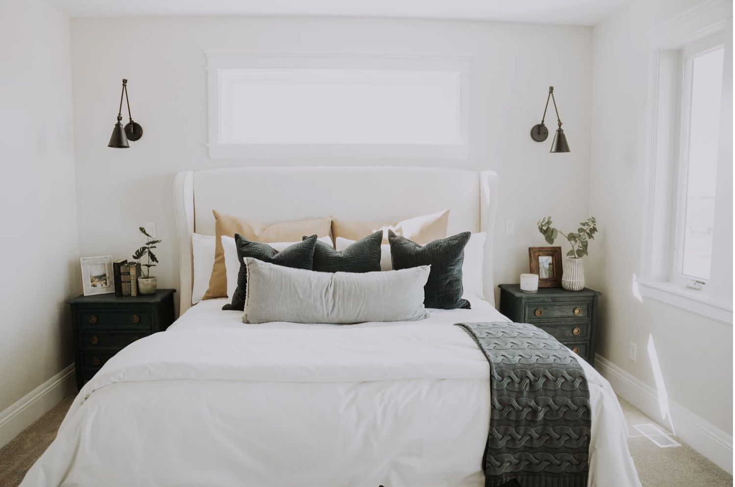 white modern bedroom with rustic farmhouse accent tables, metal wall sconces
