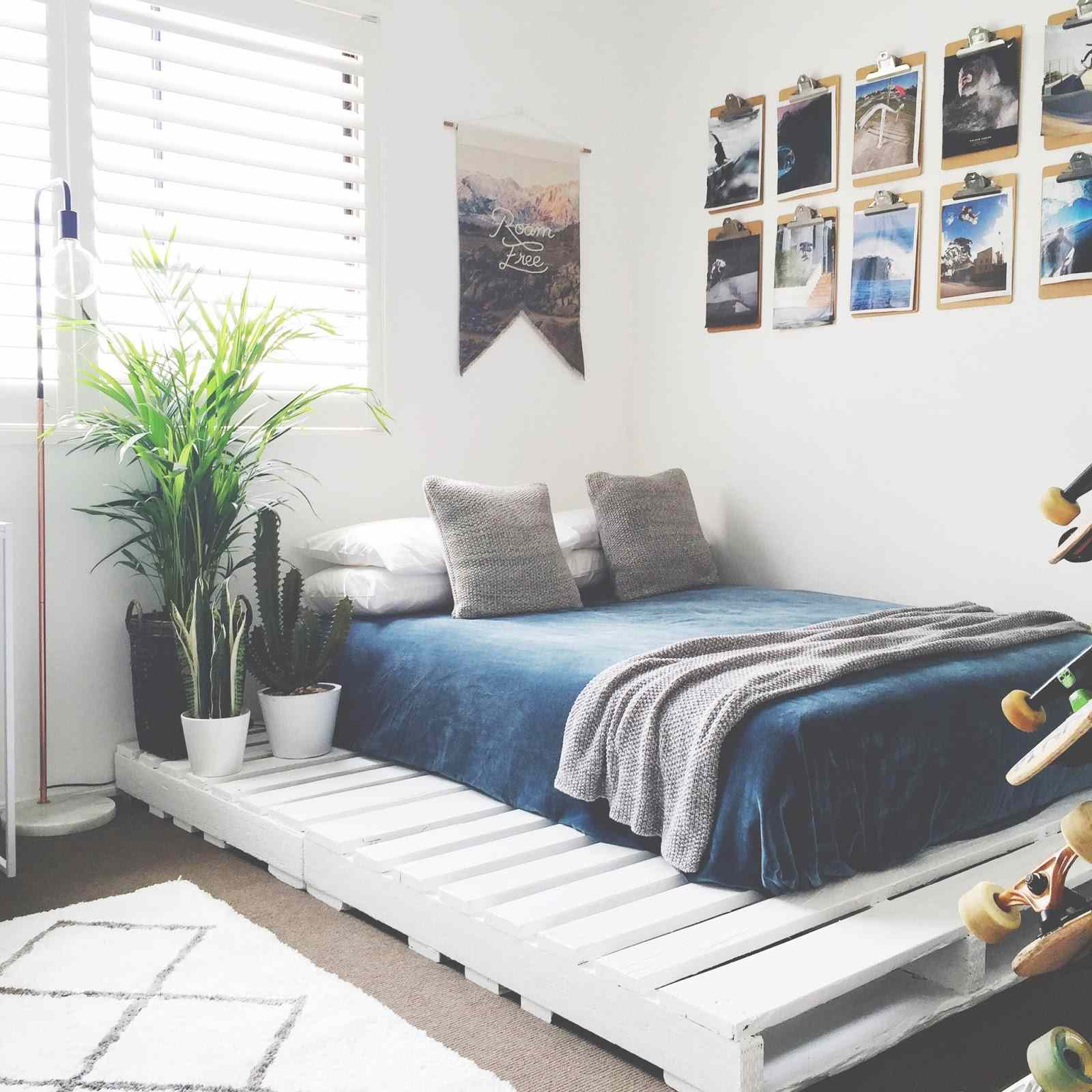A bedroom with a pallet bed