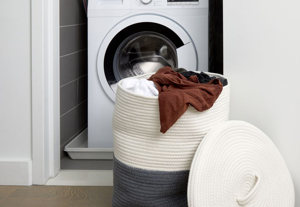 laundry hamper in front of a washer