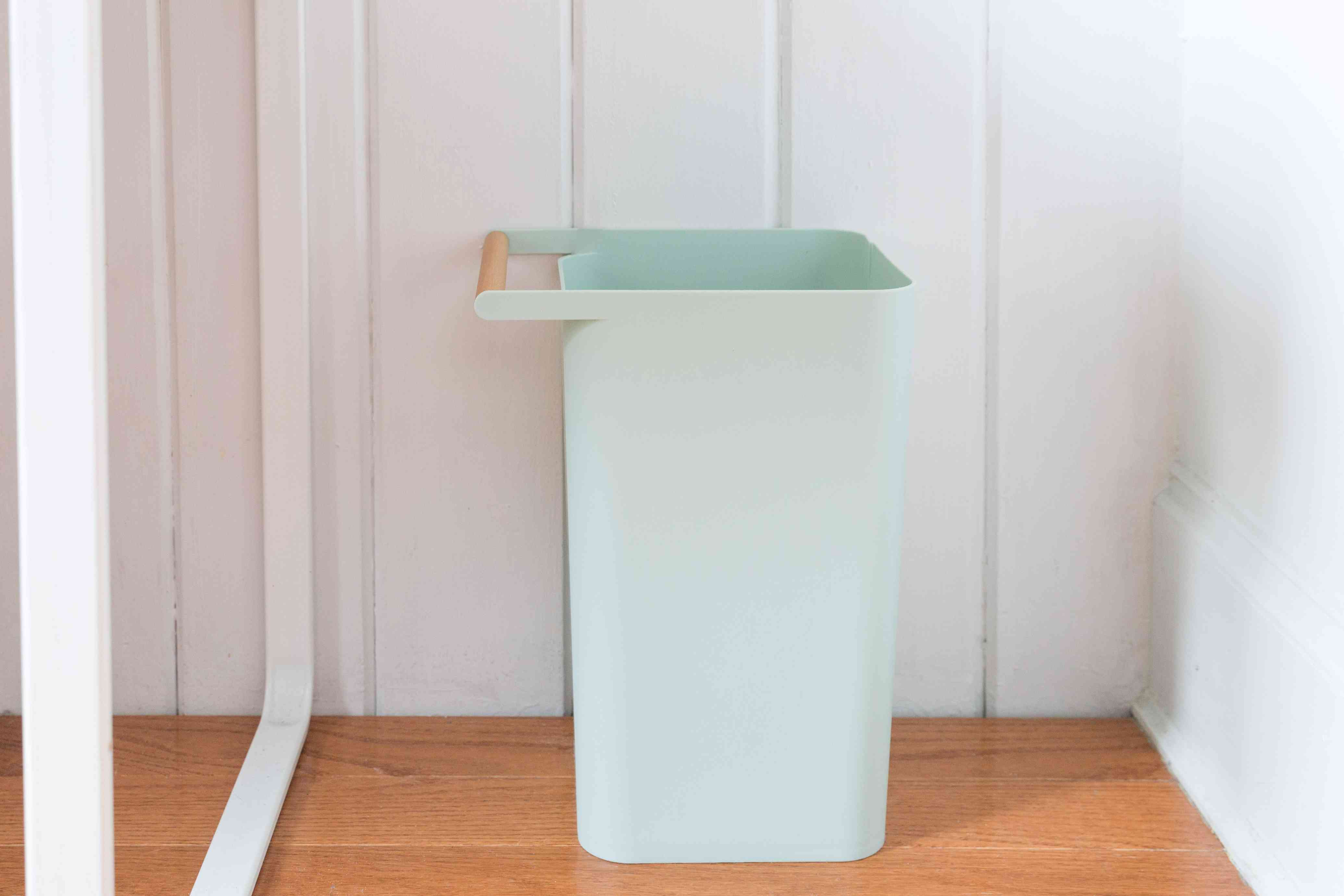 trashcan next to a desk