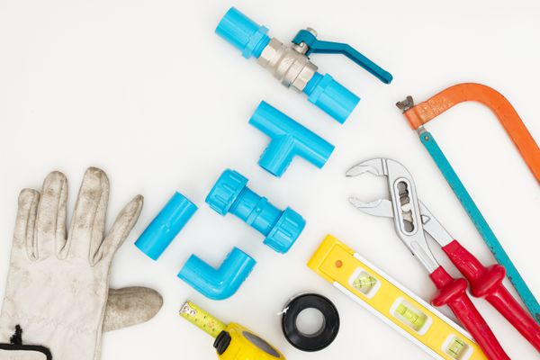 Pipe work tools set on white background.