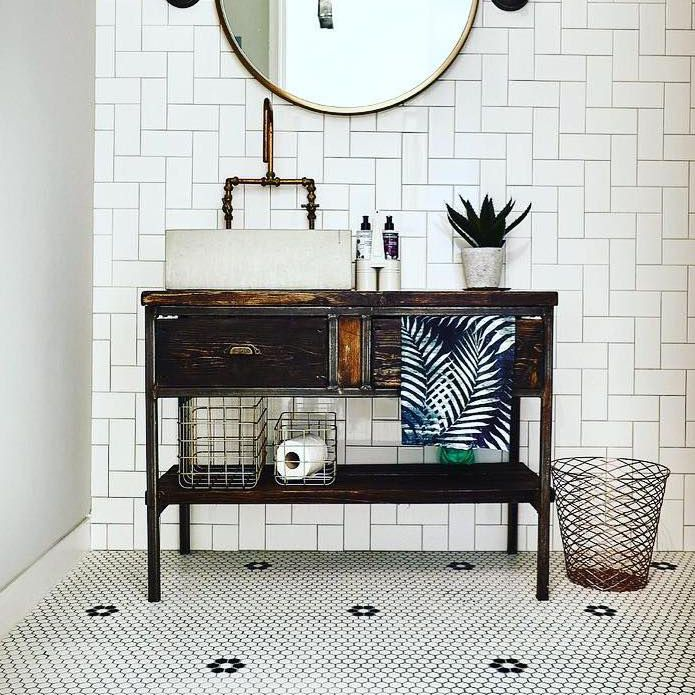 Bathroom with tile that says powder room