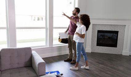 Homeowner Talking to Window Contractor