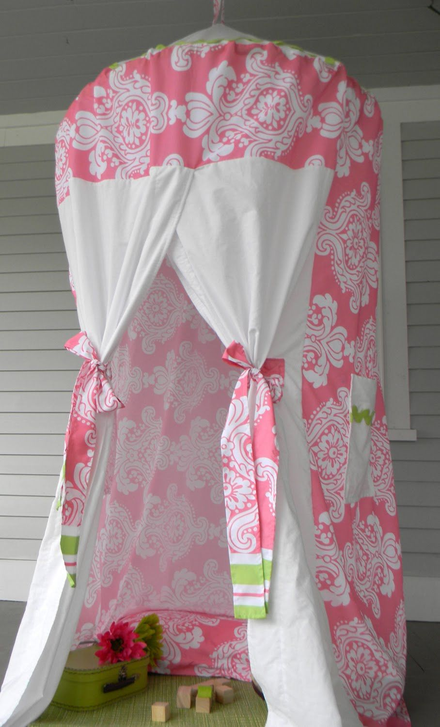 A pink and white play tent