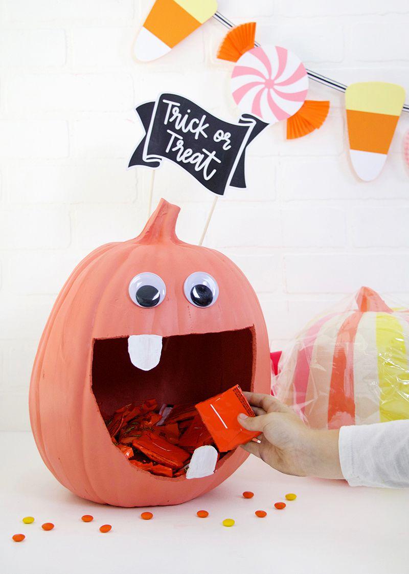 A giant pumpkin holding candy