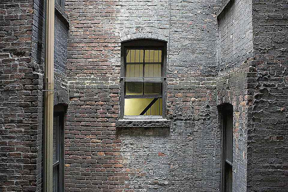 Open window in old apartment building