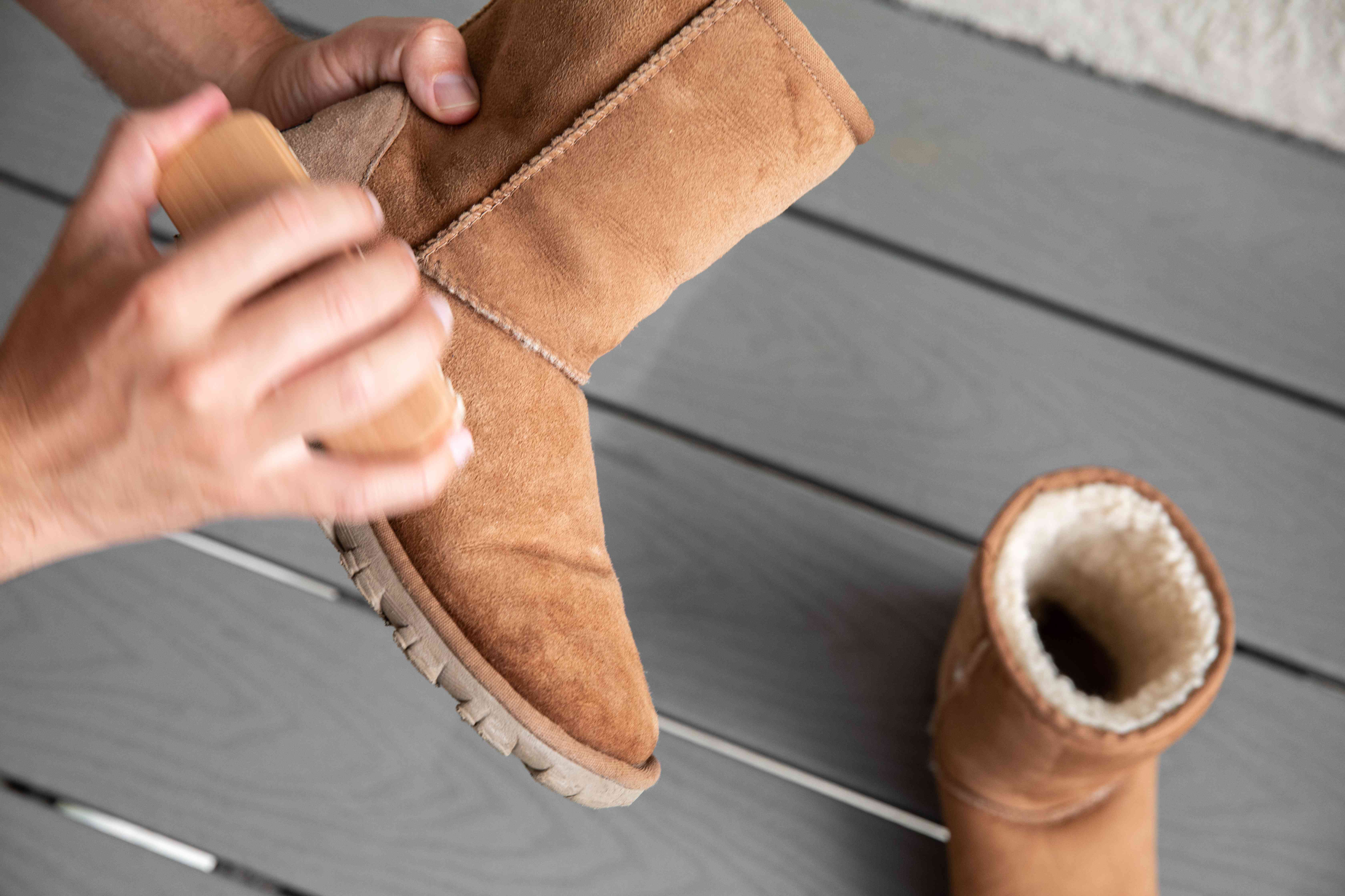 Someone brushing Ugg boots