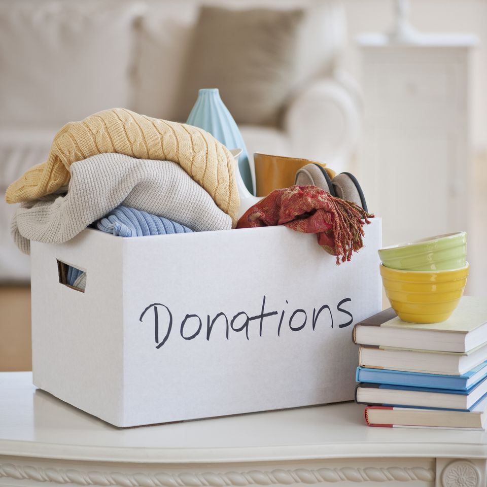 Image result for someone decluttering their house donating