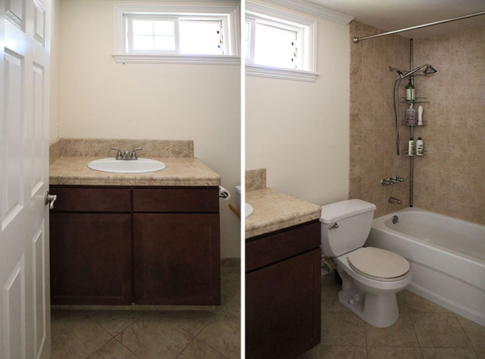 Outdated builder-grade bathroom with bathtub and shower.