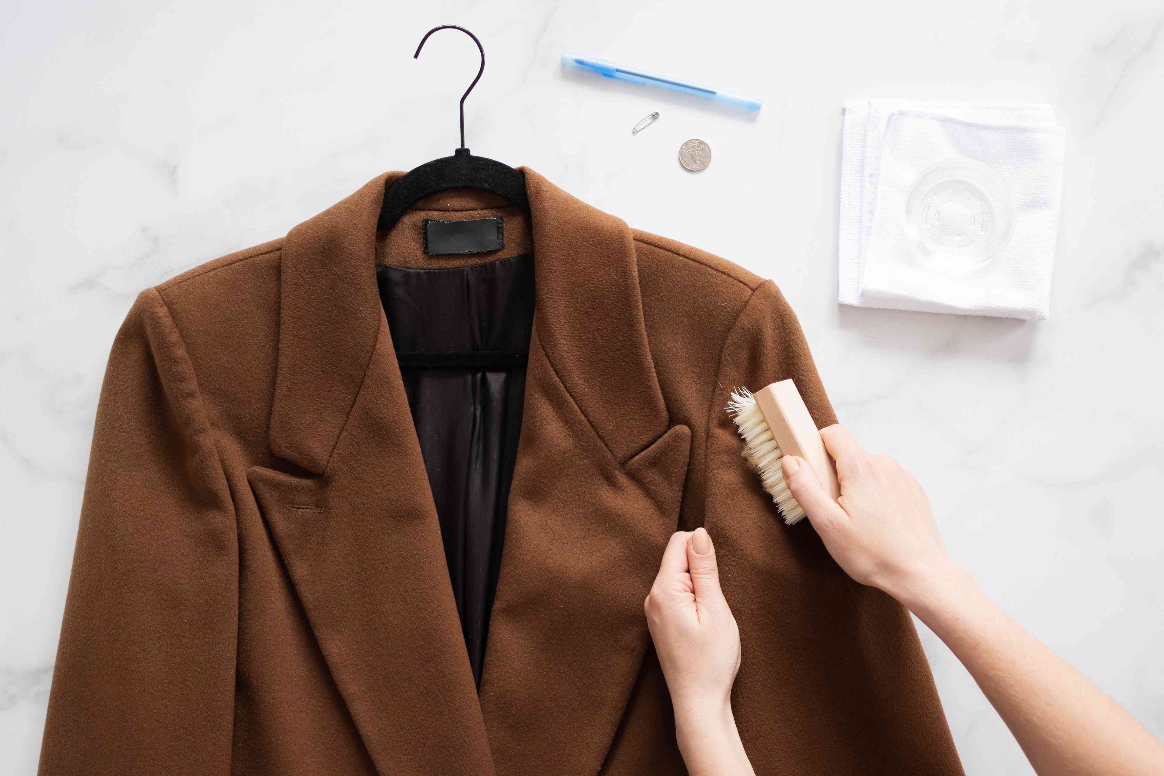 Brushing the wool coat to get any stains out