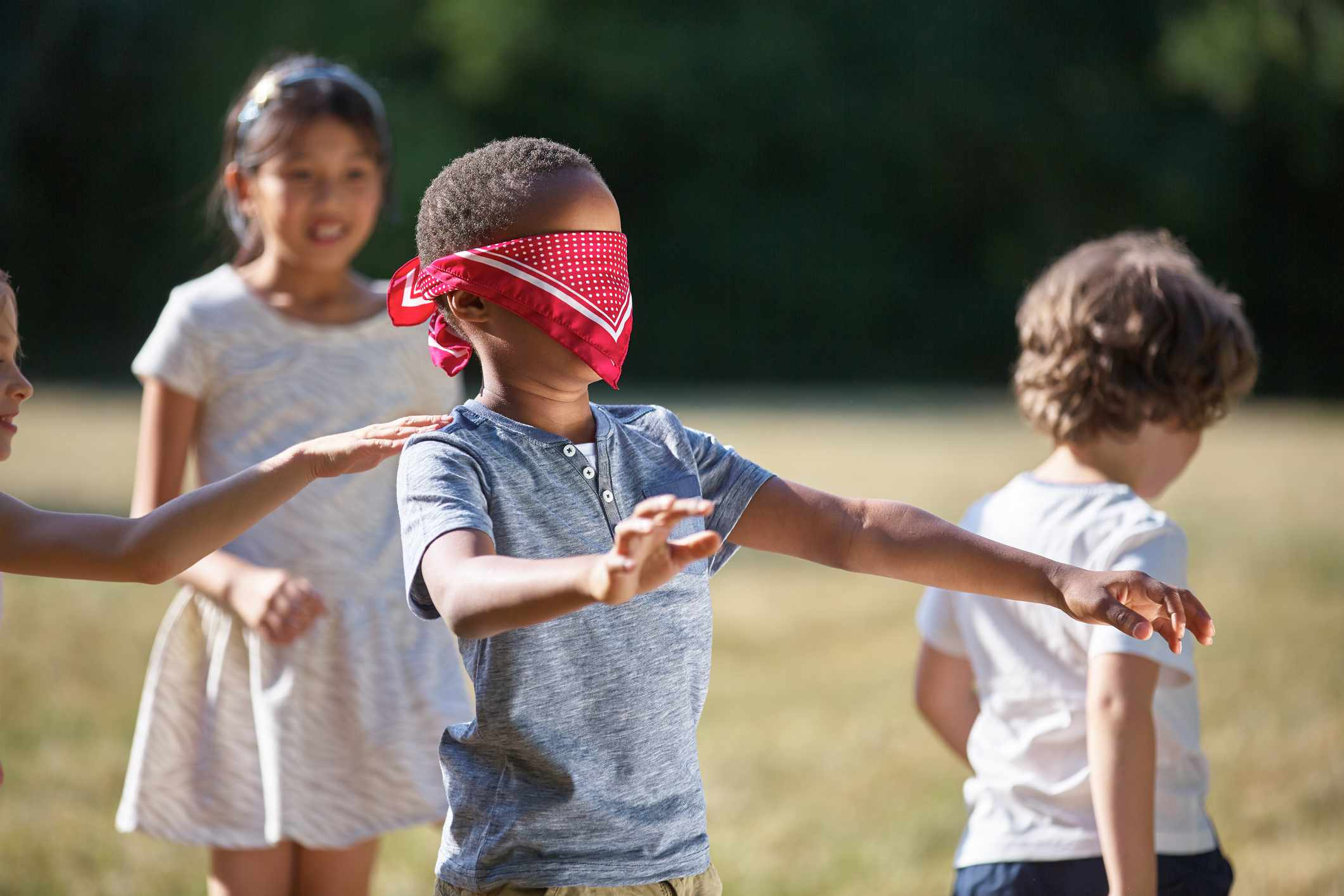 Blindfold Boy Searching Friends On Field