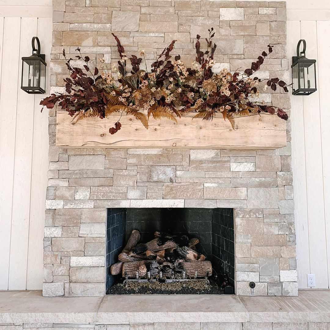 floral arrangement above fireplace on mantel