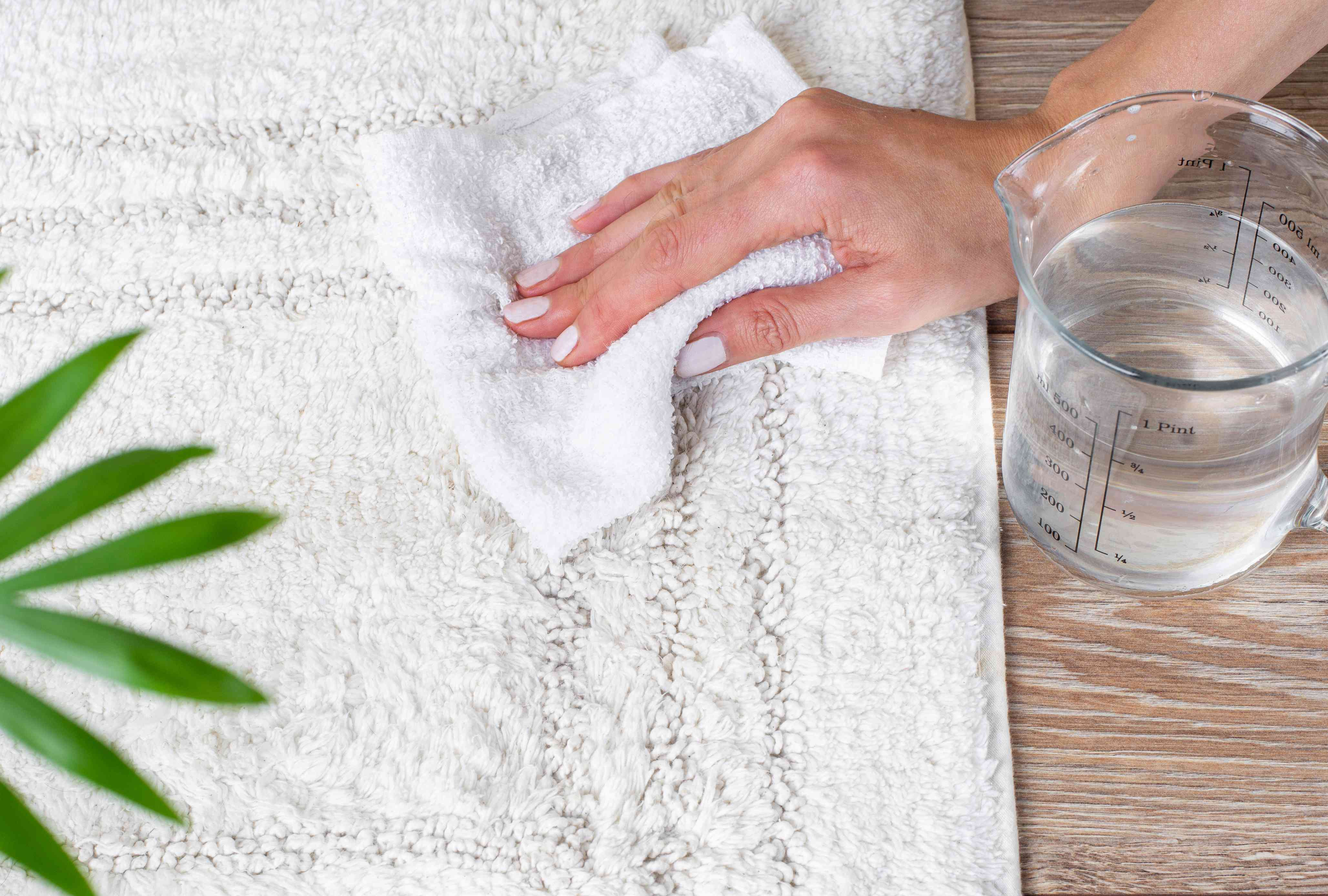 blotting the stain with a white cloth