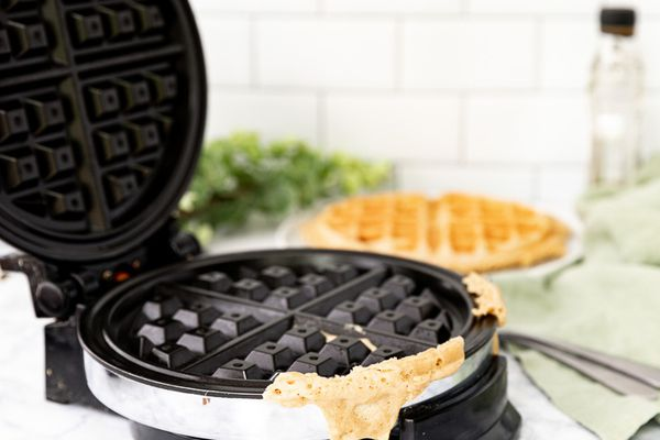 waffle iron with batter stuck to it