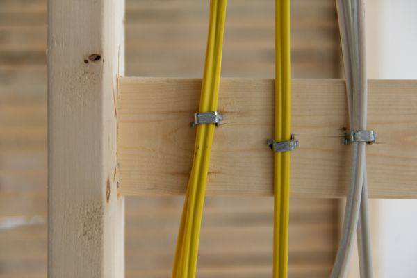Electrical wires stapled to wood stud