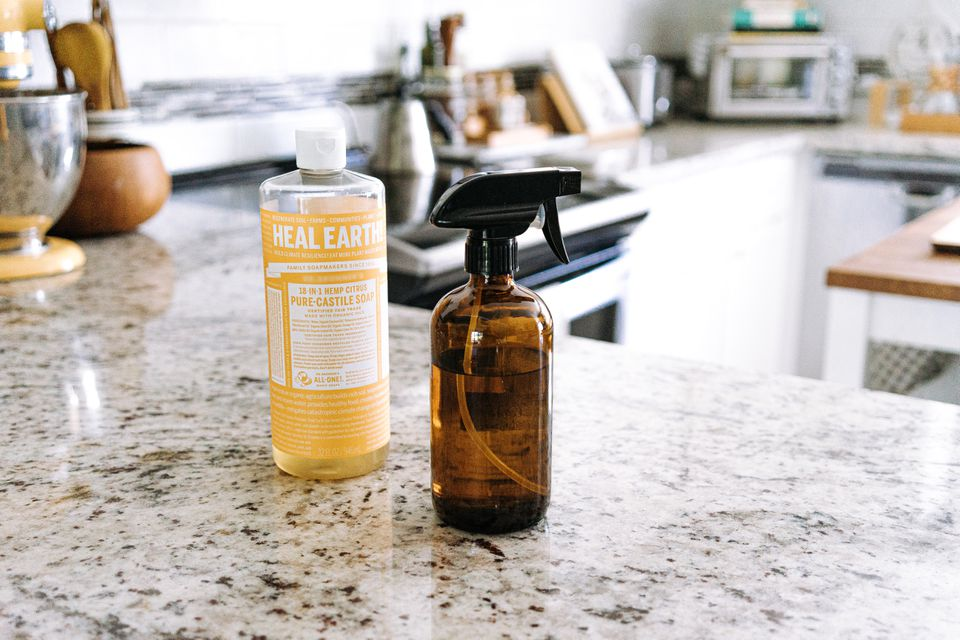 castile soap and spray bottle in the kitchen
