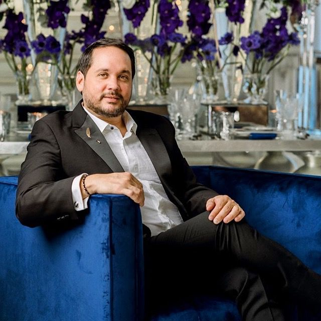 Javier Martínez poses in a royal blue chair